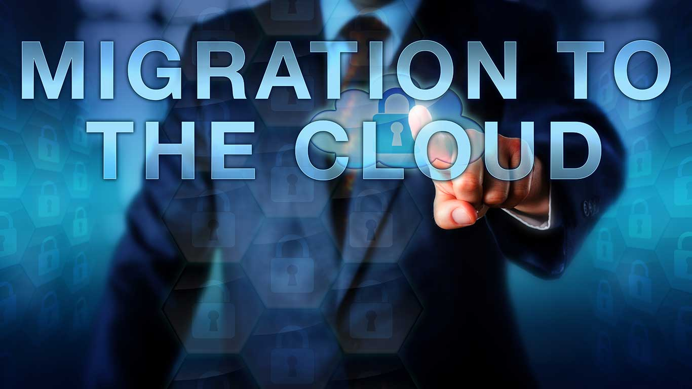 Business consultant pushes MIGRATION TO THE CLOUD on a touchscreen interface. Business metaphor and IT concept for enterprise cloud service integration.